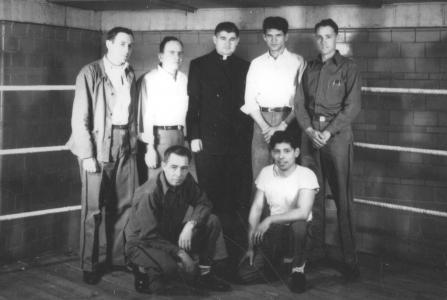 Chaplain with six prisoners from the mid-20th century.