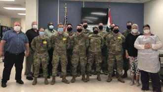 National guardsmen, medical staff and prison staff wearing masks, ready for testing